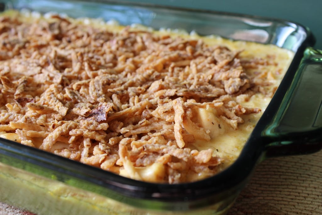 This creamy chicken and rice casserole is pure comfort food at it's best. It's thick creamy sauce covering chicken flavored rice, with chunks of chicken, and topped with crispy onions.