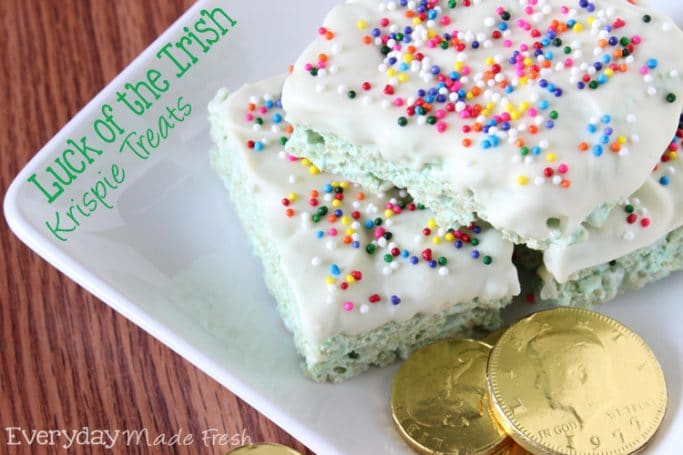 Luck of the Irish Rice Krispie Treats are green, topped with white chocolate, and covered in rainbow sprinkles. These are perfect St. Patrick's Day Rice Krispie Treats! | EverydayMadeFresh.com