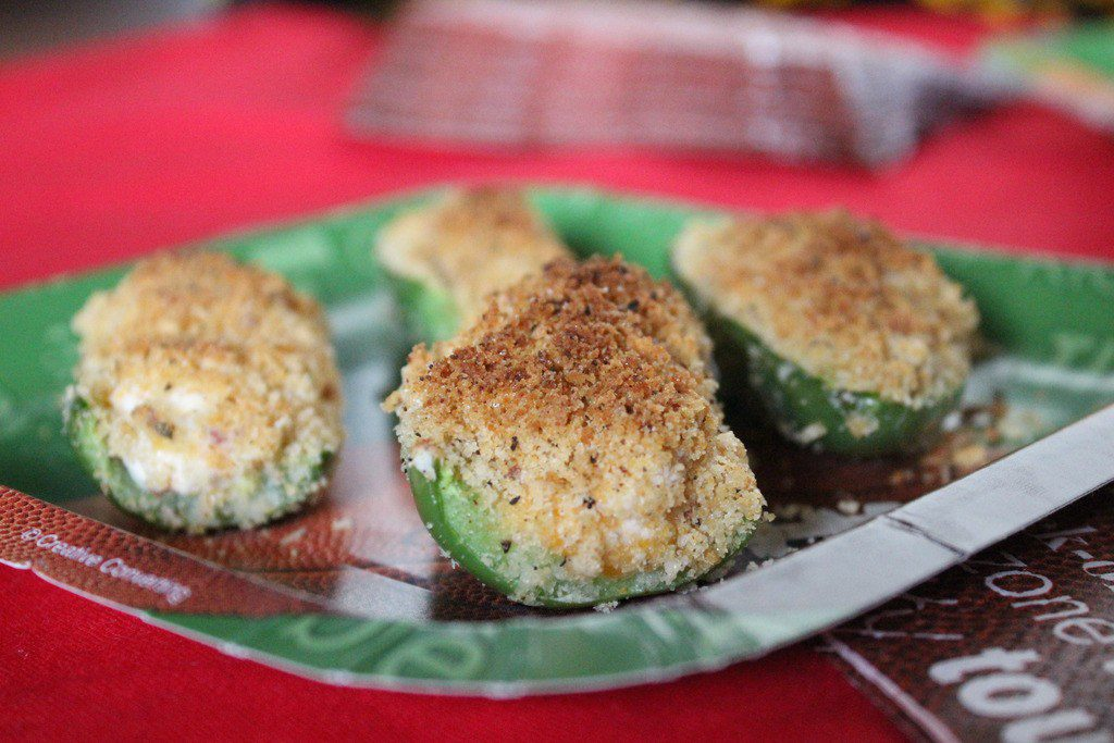 Stuffed with a cream cheese, bacon, and sharp cheddar mixture, topped with panko and baked in the oven, these baked jalapeno poppers are delicious!