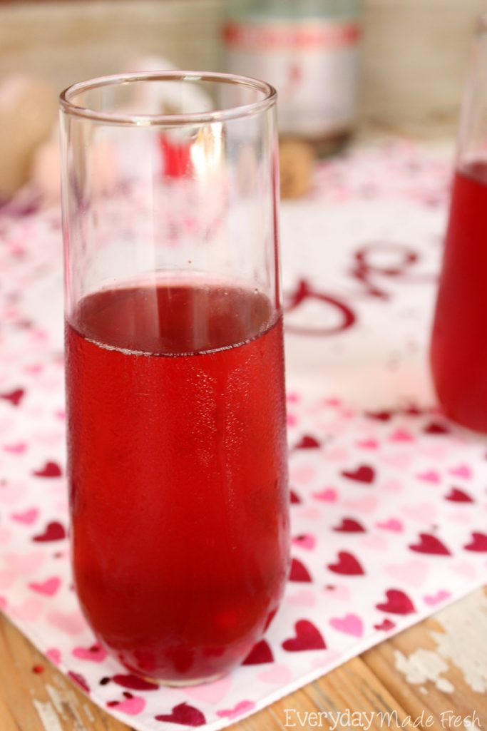 "The perfect drink to enjoy on the official day of ""love"", has to be red! These Valentine's Mimosas are made with pink champagne and pomegranate juice; the perfect combination. 