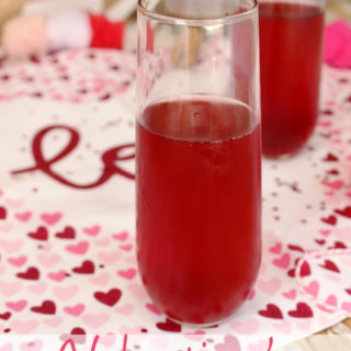 "The perfect drink to enjoy on the official ""love"" day has to be red! These Valentine's Mimosas are made with pink champagne and pomegranate juice; the perfect combination. 