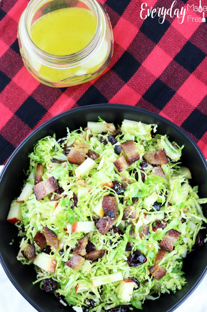 If you've never eaten sprouts fresh, you don't know what you're missing out on! You've got to give this simple recipe for Brussels Sprouts Salad with Apple, Bacon, Cranberries & a Citrus Dressing a try. Fresh, sweet, and tangy it's the perfect healthy side! | EverydayMadeFresh.com
