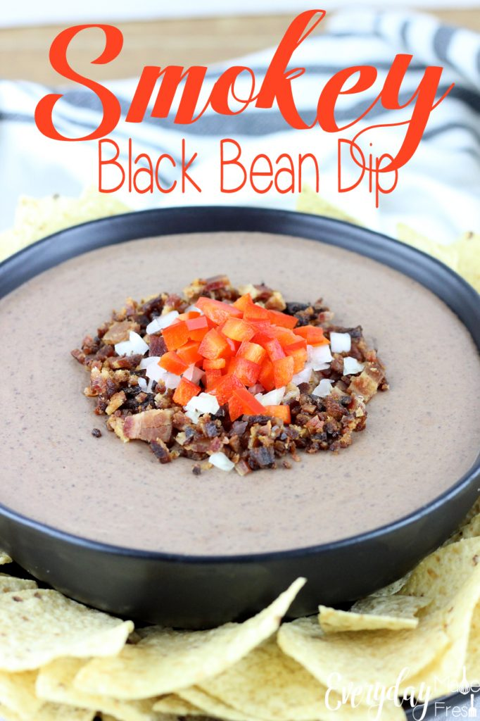 This Smokey Black Bean Dip is simple to make, and only requires 8 ingredients! It's creamy, smokey, and spicy, everything you want in a black bean dip! This dip is made for , holidays, parties and tailgating.   EverydayMadeFresh.com