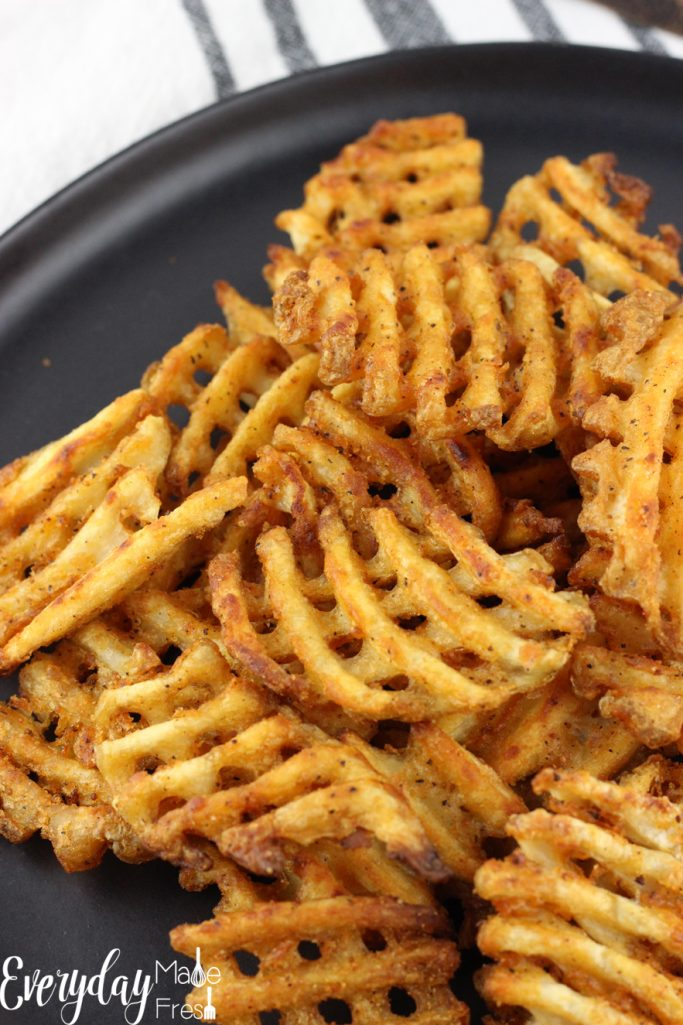 Pork & Waffles is our take on the world famous BBQ Butt Fries.  Waffle fries are the perfect vessel for slow cooked pulled pork, drizzled in BBQ sauce, and topped with fresh scallions. #Potatoes #CLVR | EverydayMadeFresh.com