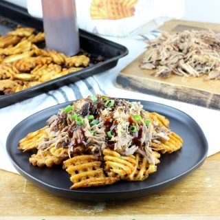 Pork & Waffles is our take on the world famous BBQ Butt Fries. Waffle fries are the perfect vessel for slow cooked pulled pork, drizzled in BBQ sauce, and topped with fresh scallions.#Potatoes #CLVR | EverydayMadeFresh.com