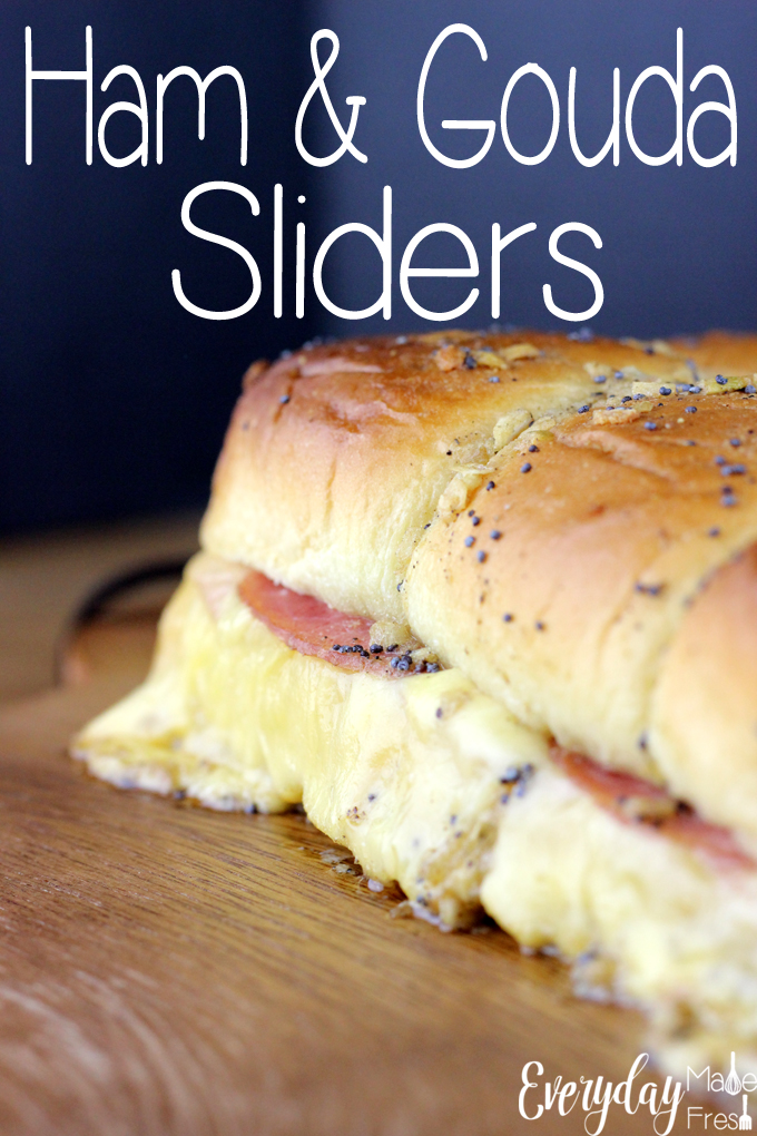 These Ham & Gouda Sliders are crowd pleasers. Melty gouda cheese and juicy ham come together with a buttery poppy seed topping that is simply amazing.| EverydayMadeFresh.com