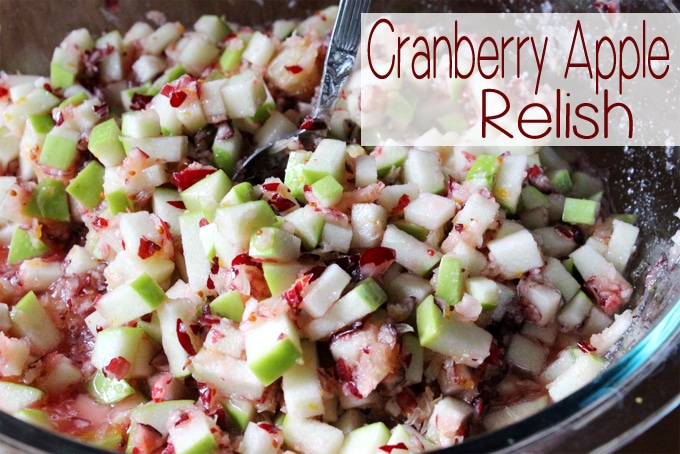 This Cranberry Apple Relish is made with tart cranberries,  granny smith apples and are combined with fresh oranges and sugar to make a scrumptious side dish to any holiday table.  | EverydayMadeFresh.com