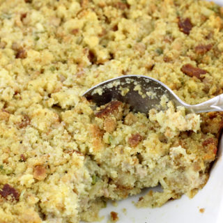 This savory Sausage Dressing uses store bought stuffing mix and a quick and easy homemade corn bread. Flavored with sage and celery, this is one of the best Thanksgiving sides that you'll ever taste.