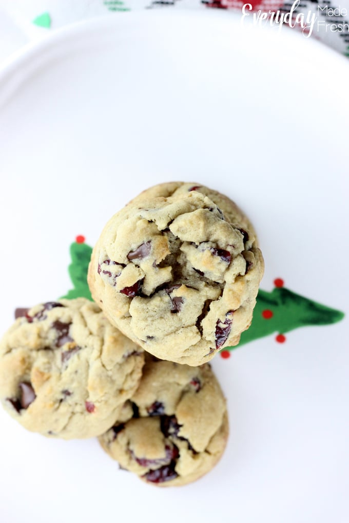 top view of cranberry chocolate chip cookies, sitting on a christmas tree plate