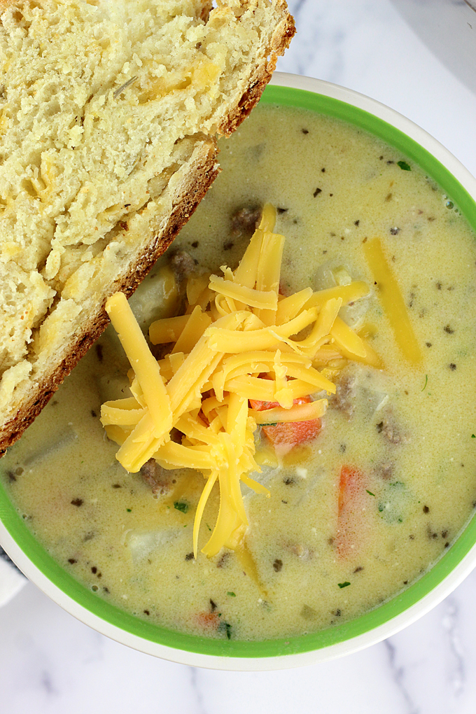 Easy Cheeseburger Soup is a creamy soup with ground beef, potatoes, vegetables, and loads of cheese! Turn America's favorite into your new favorite soup! | EverydayMadeFresh.com