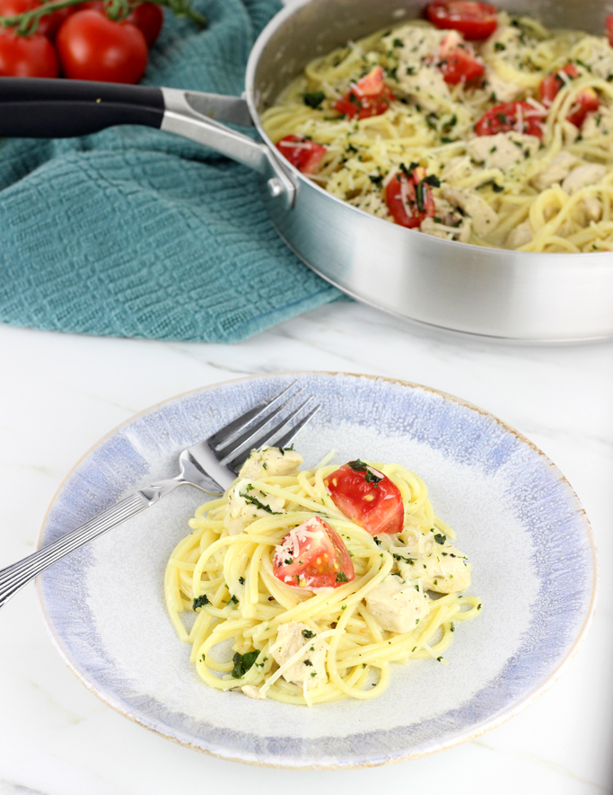 The Best Chicken Spaghetti with Creamy Garlic Sauce is a family favorite! A simple creamy garlic sauce tops spaghetti noodles and lemon and thyme seasoned chicken for a meal that everyone will love.