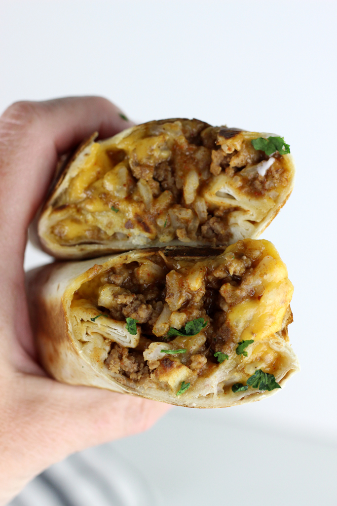 Grilled Stuffed Burritos are made with seasoned ground beef, rice, refried beans, and cheese. It's the perfect for taco Tuesday!