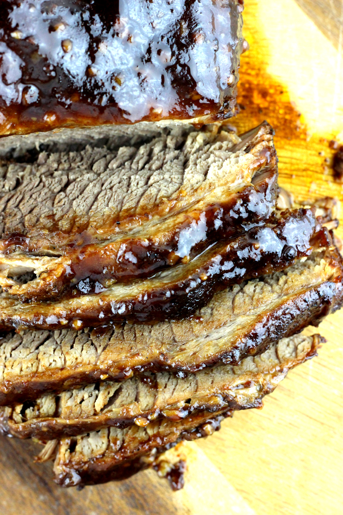 This juicy beef brisket recipe is easy to make - rubbed in a delicious dry rub and then smothered in barbecue sauce. I'll show you how to make easy moist instant pot brisket!