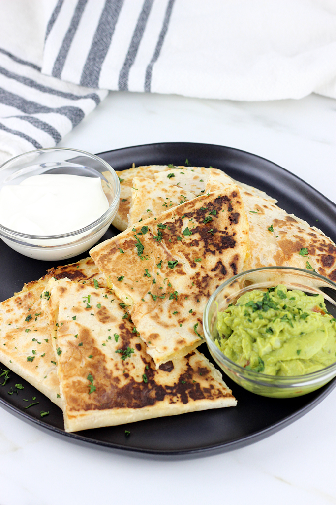 These Spicy Cheesy Chicken Quesadillas are loaded with chicken, shredded cheese and have a with a spicy jalapeno sauce that make these the best homemade quesadillas ever!