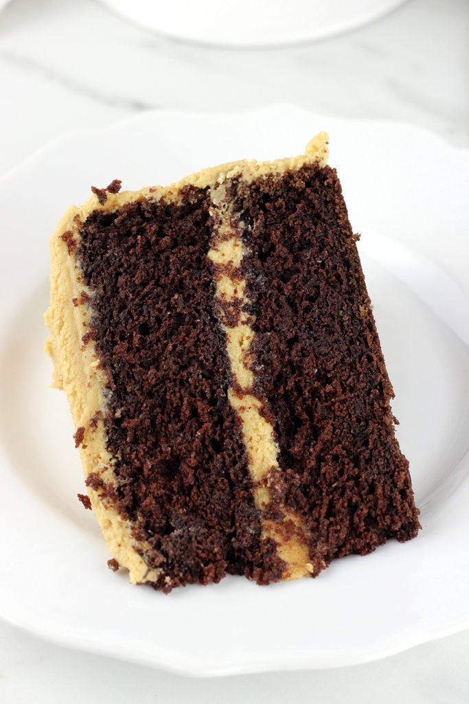 Moist and decadent chocolate cake, smothered with the creamiest peanut butter frosting. The best part is, this is the best chocolate cake with peanut butter frosting!
