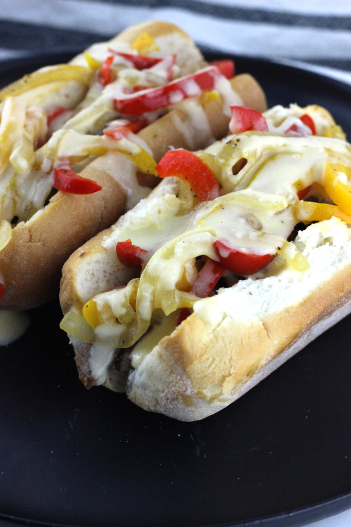This is no ordinary cheesesteak here. This is The Best Philly Cheesesteak Recipe with Provolone Cheese Sauce.  Ribeye steak, caramelized onions and bell peppers topped with a gooey melty finger licking good cheese sauce!