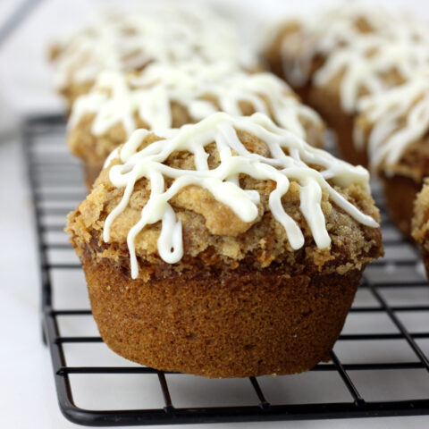 Streusel Topped Pumpkin Muffins with Cream Cheese Drizzle