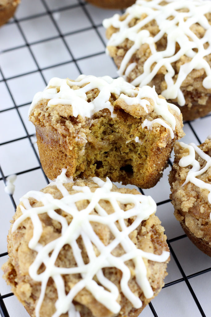 It's pumpkin season, and these fluffy Pumpkin Muffins with a Streusel Topping and Cream Cheese Icing are delectable!