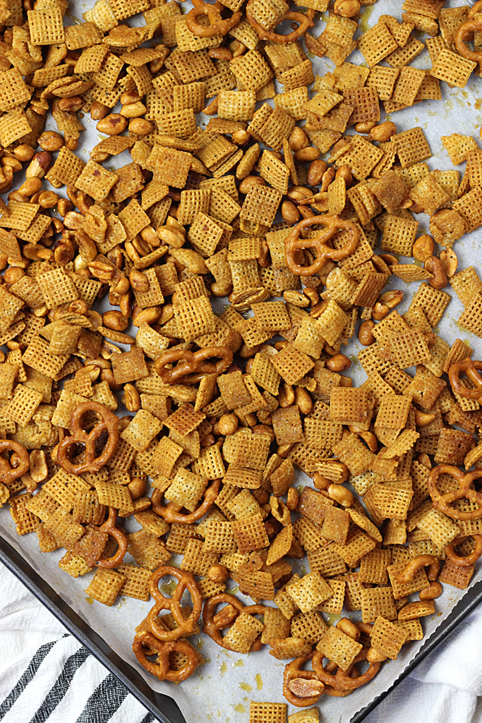 This sweet and spicy chex mix is the perfect blend of flavors. Ingredients include honey, hot sauce, and seasonings and it makes this Sweet Heat Chex Mix, your next addictive snack!