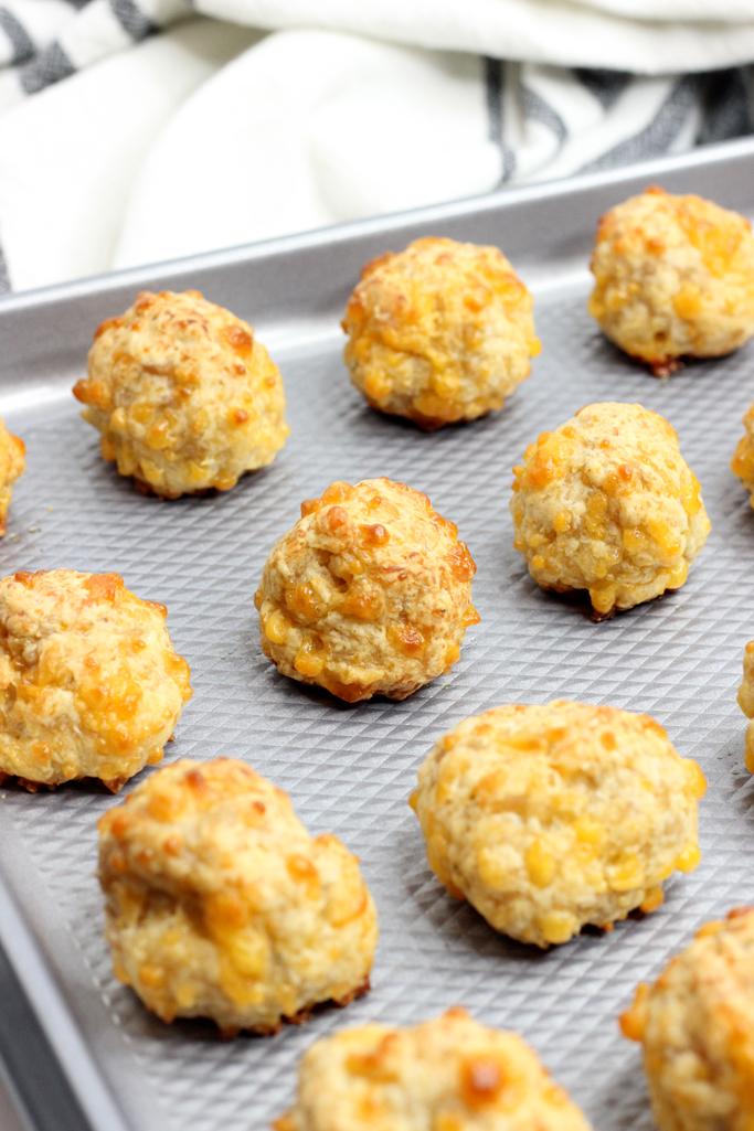 baked cheeseballs on a baking sheet